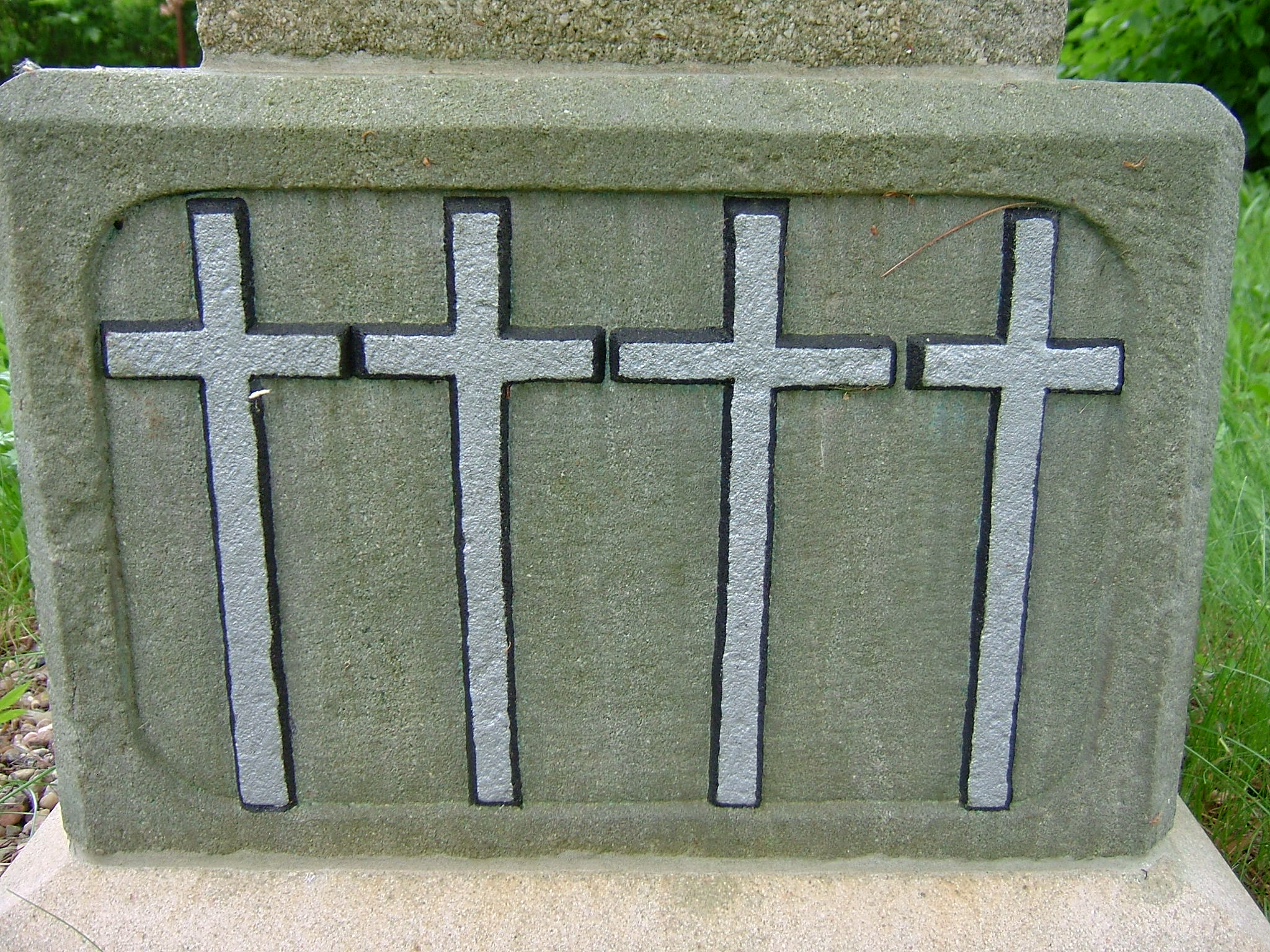 Kříž na hromadném hrobě
